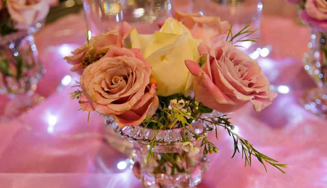 Roses in vase with pink chiffon e1587386595661