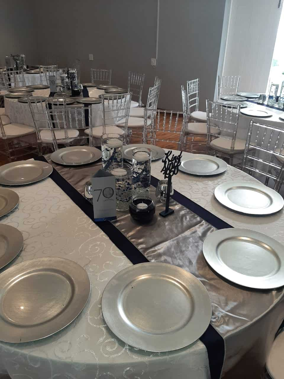 Silver Plates on a silver overlay on a round table