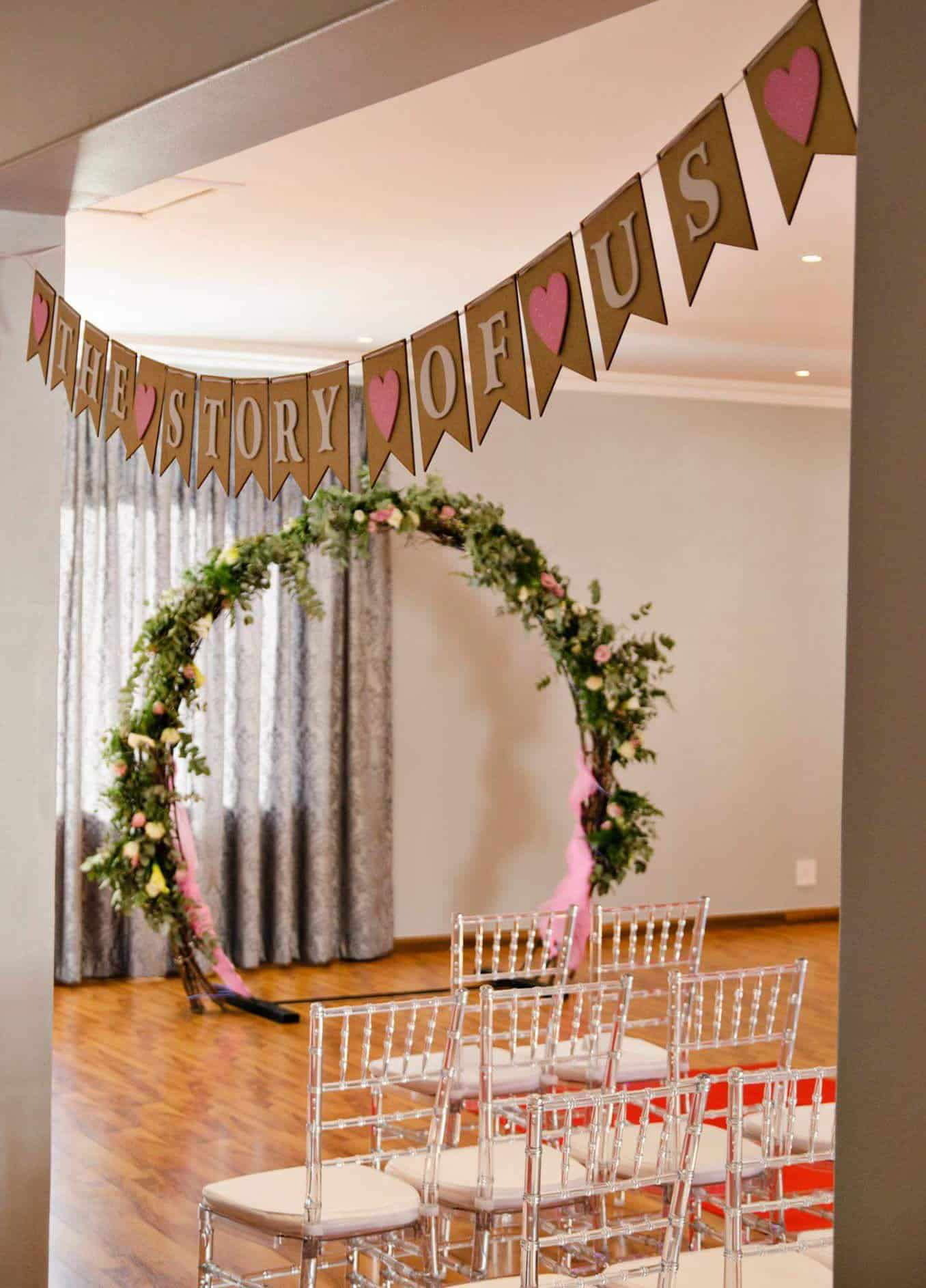 Wedding arch with tiffany chairs