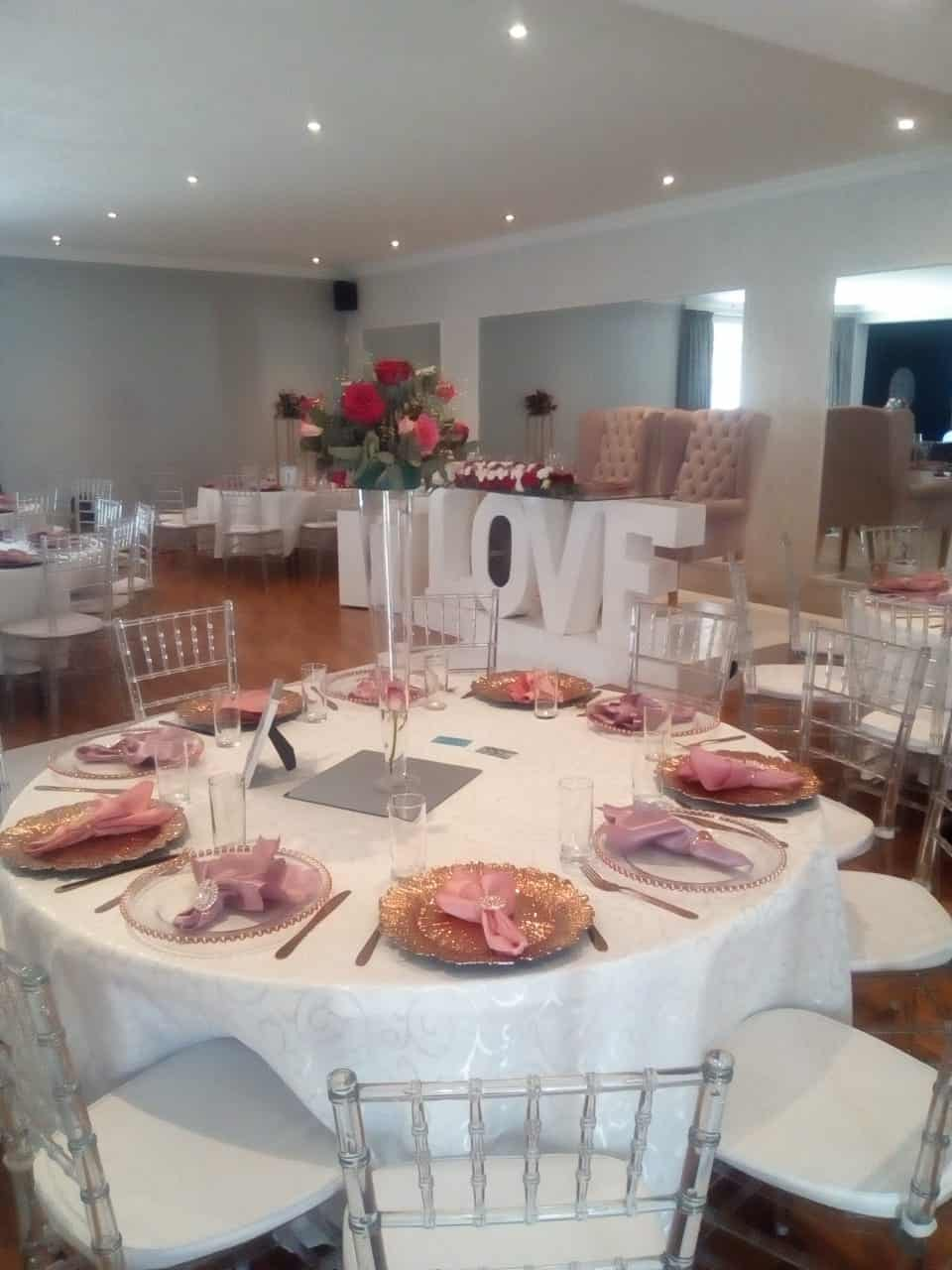 White Love sign with 2 chairs for the bride and groom