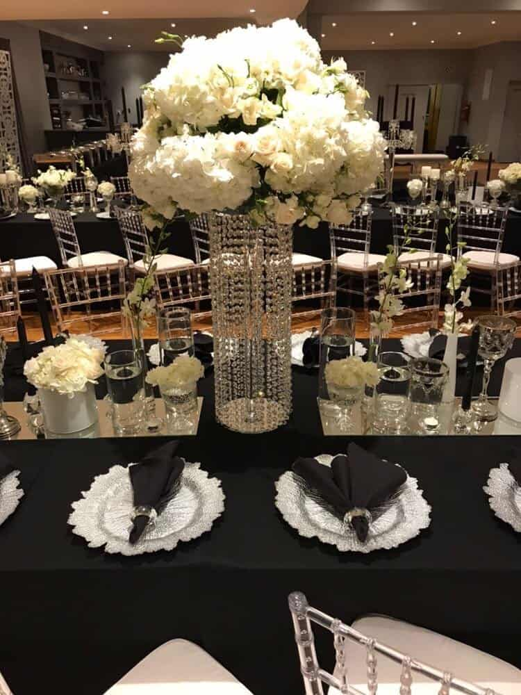 black and cream table with flower centre piece