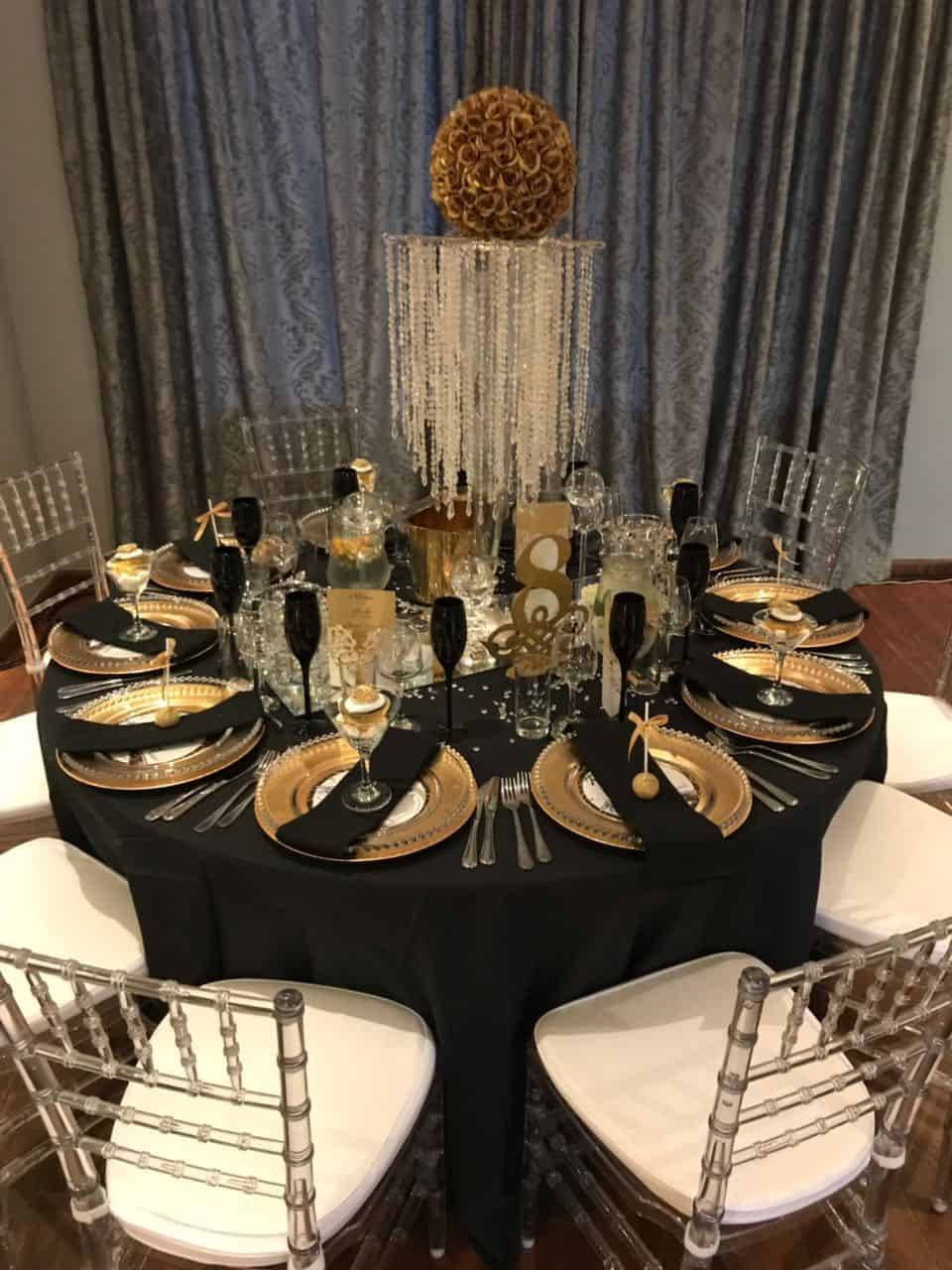 black overlay with gold plates and black serviettes