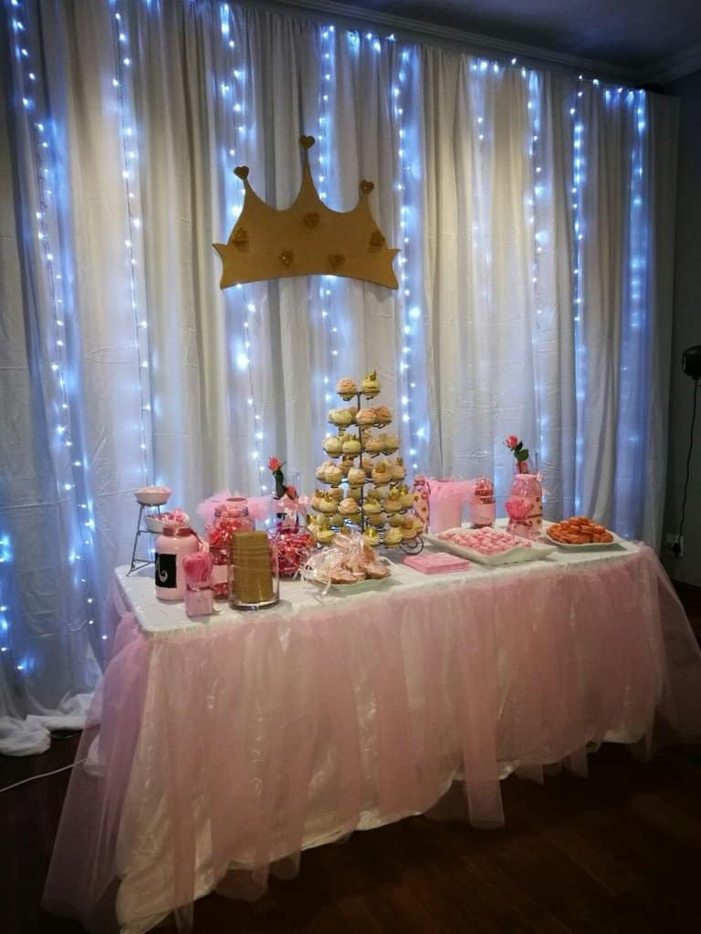 blue fairy ligths with dessert table
