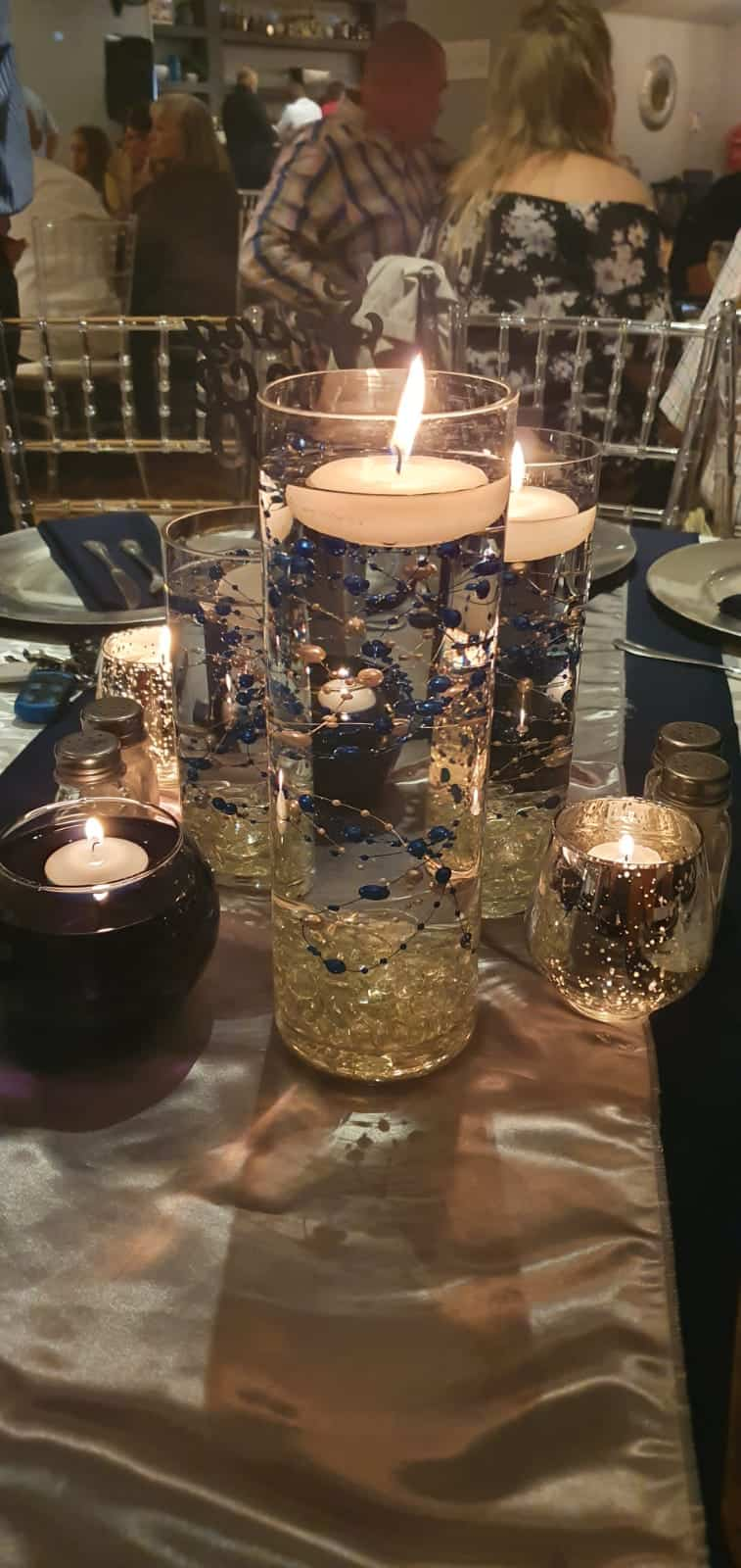 candle surrounded by other candles