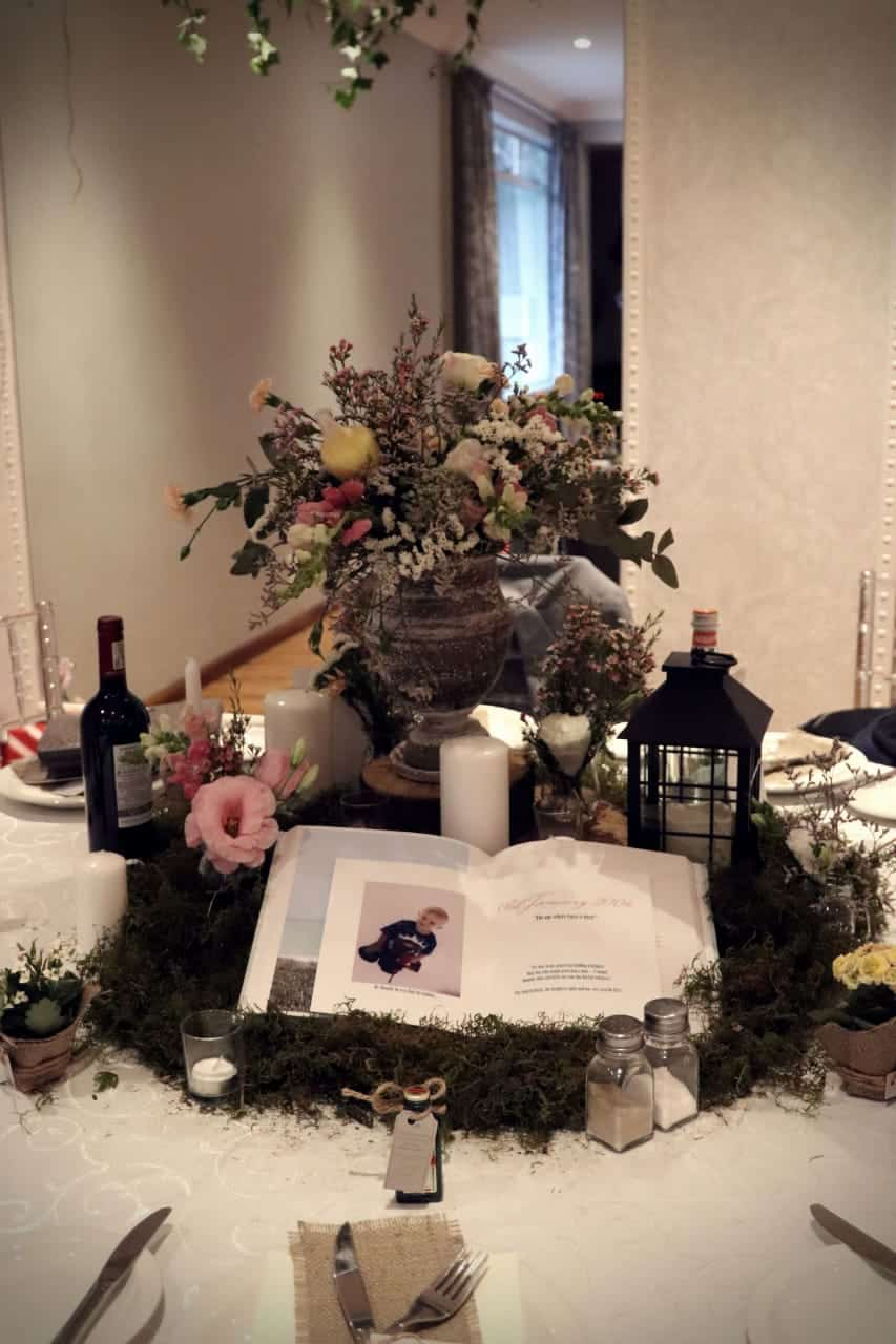 center piece with book and flowers