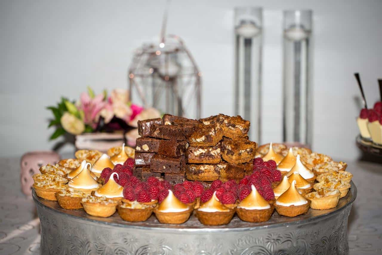 desserts on round table with candles