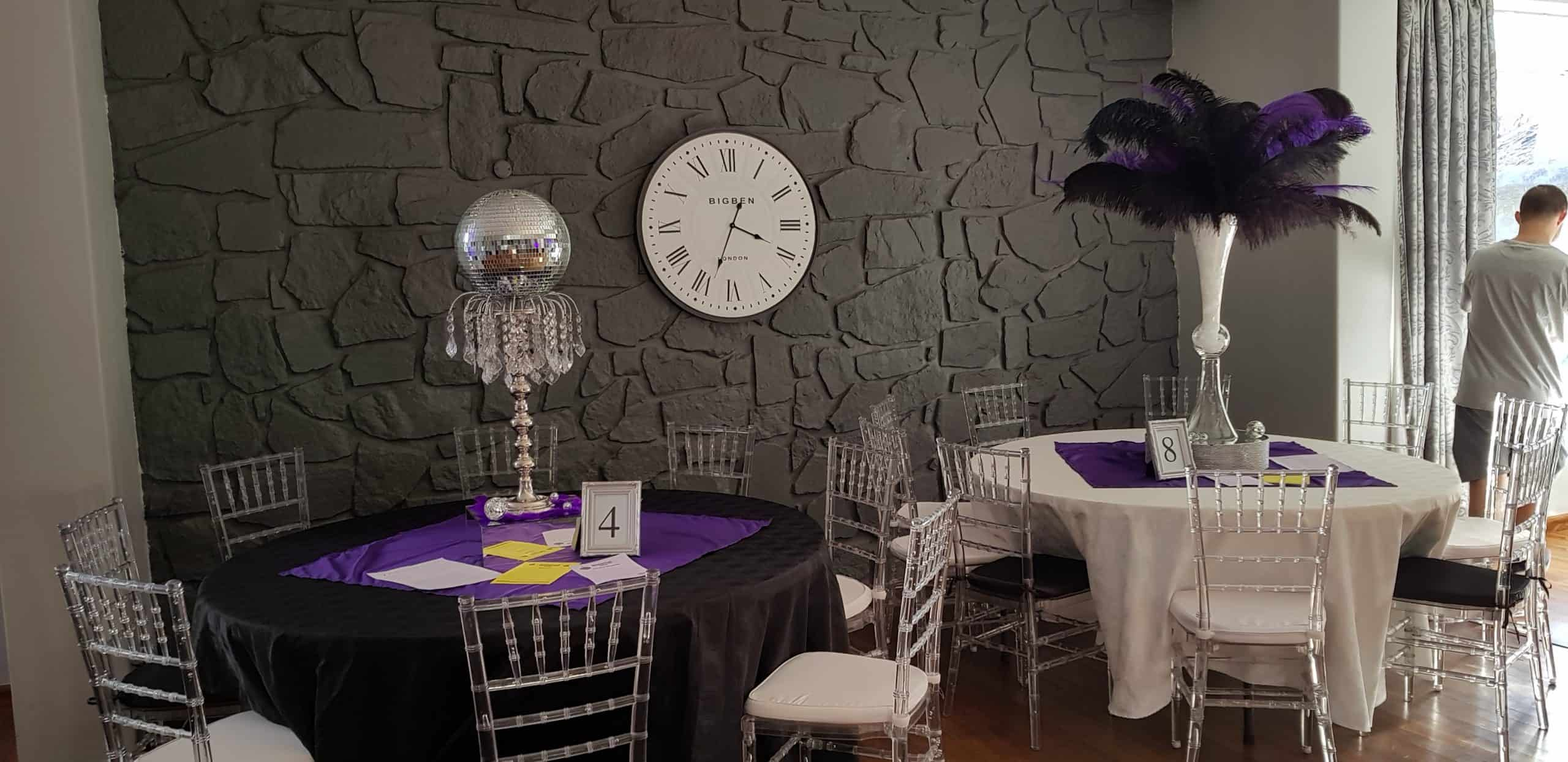mirror ball and purple overlay with another white table overlay and feather centrepiece scaled