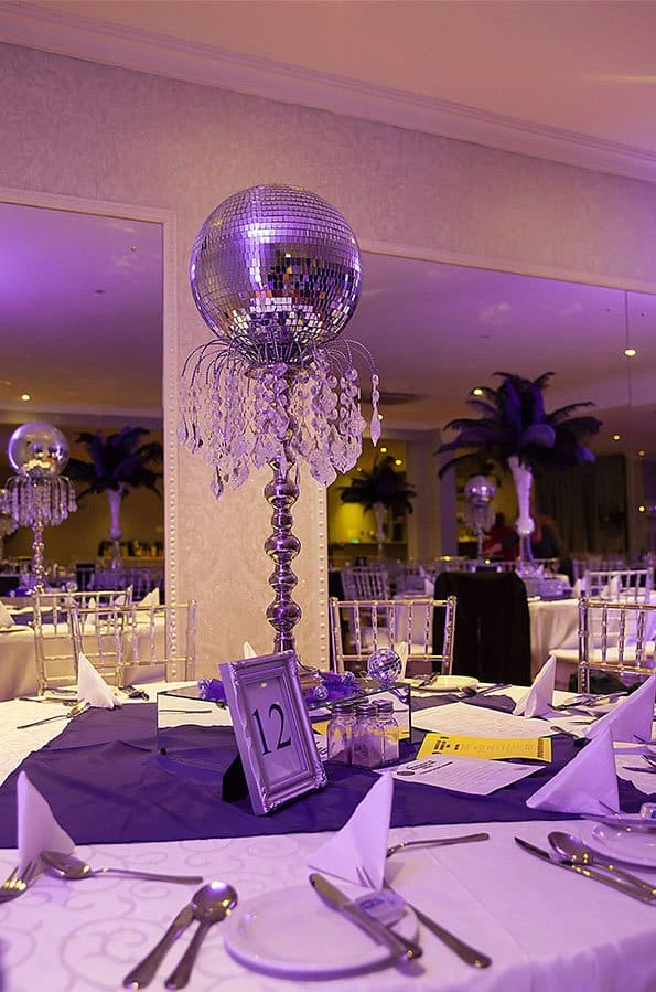 mirror ball in center of table purple