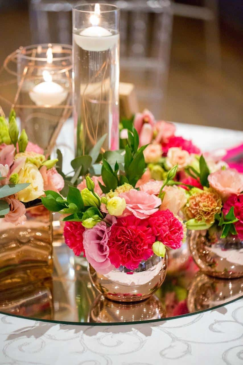 mirror plate with flowers and candles