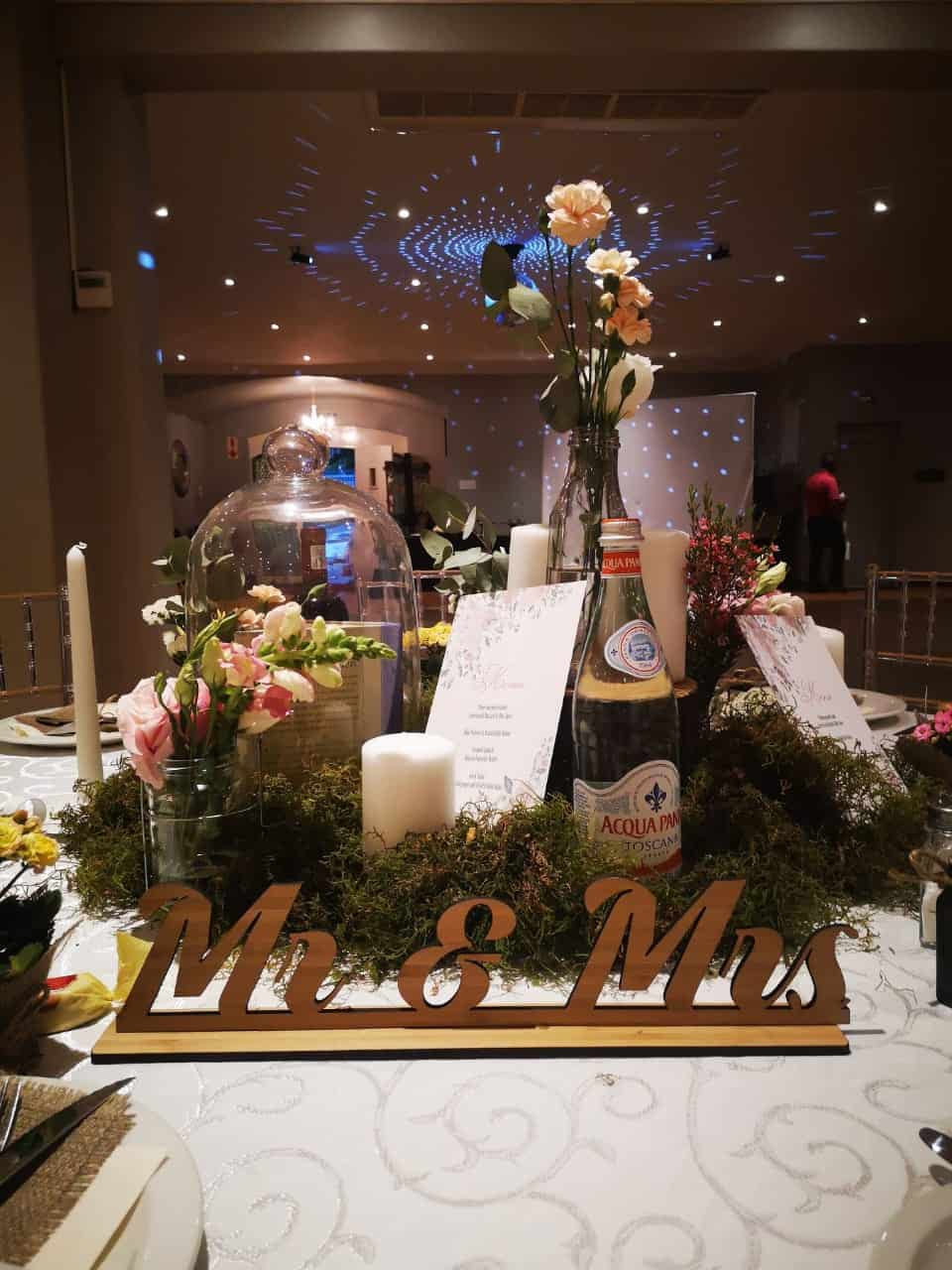 mr and mrs with table settings