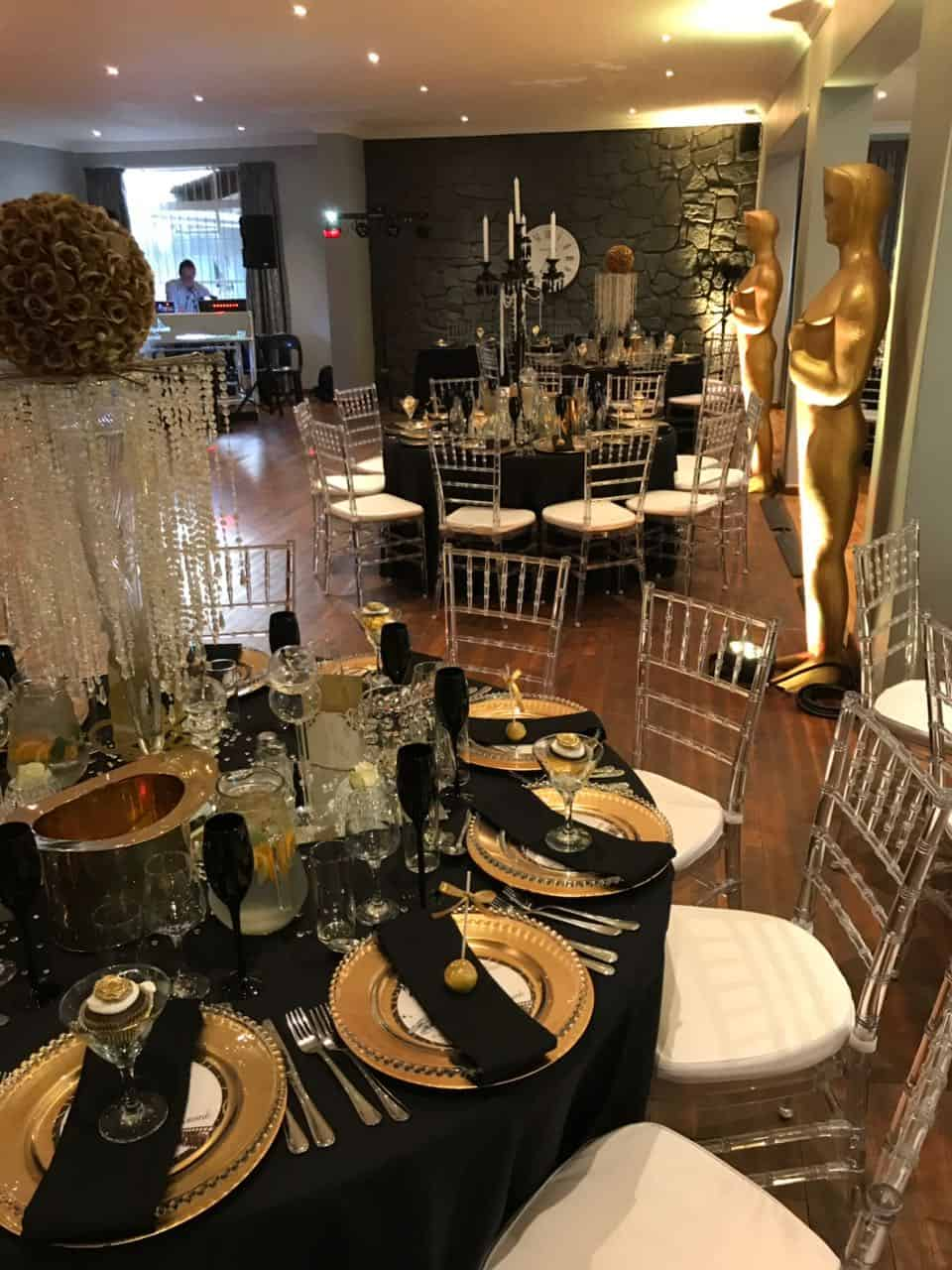 oscar party with satues and gold plates