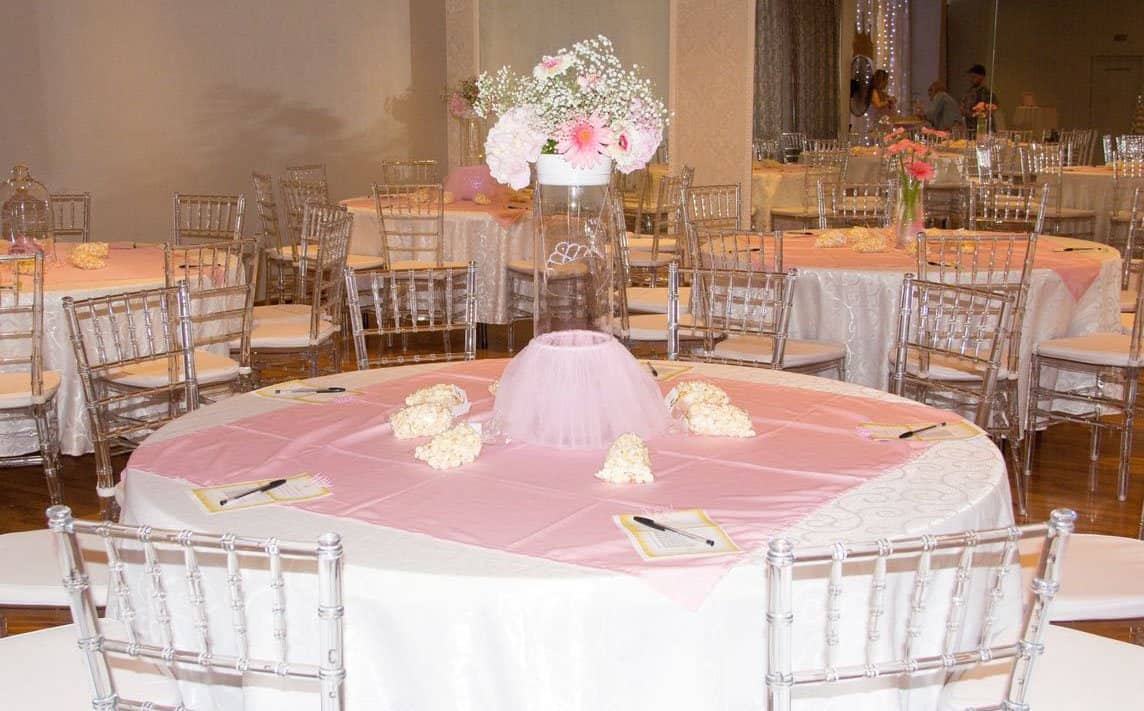 pink overlay with white damascus tablecloth with tiffany chairs