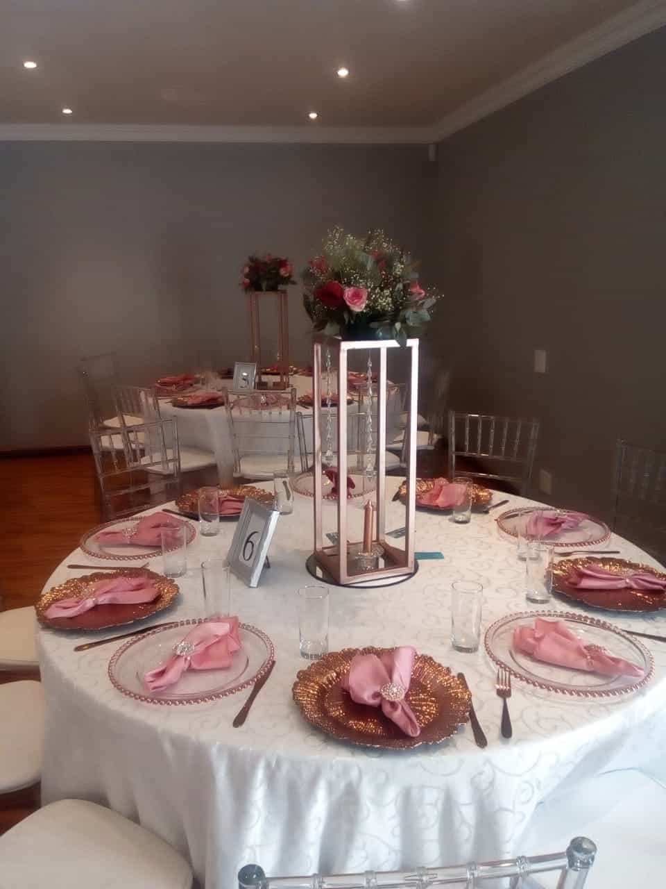 pink plates on a white table cloth
